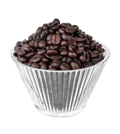 Coffee beans in a clear glass isolated on white background Foto de archivo