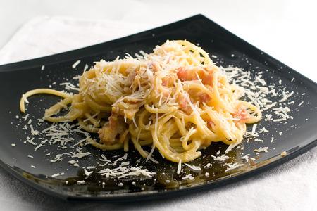 carbonara: Spagetti carbonara on a black plate Stock Photo