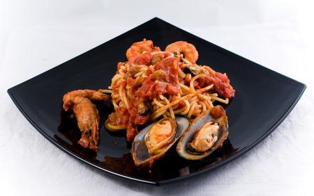 Spaghetti Marinara with mussel om a black plate Stock Photo - 1536095