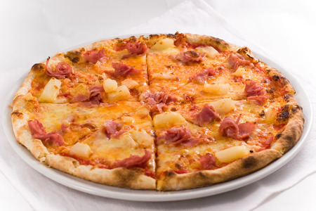 Pizza with ham and pineapple photo