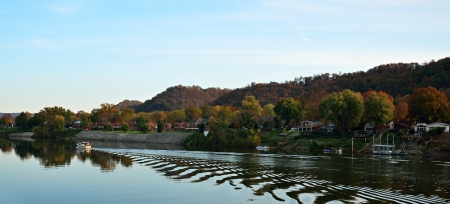 west virginia trees: Boat on the river