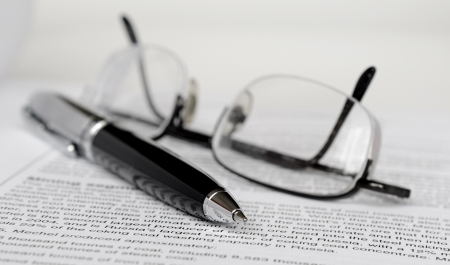 Pen and glasses on paper Stock Photo - 17961463