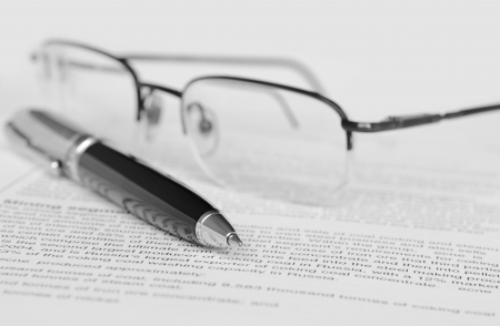 Pen and glasses on paper Stock Photo - 17961454