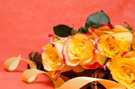 Background with yellow roses and a ribbon photo