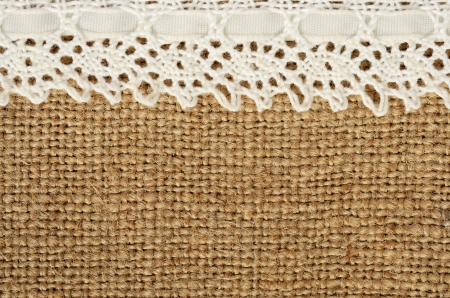 sackcloth: Canvas background with lace on the edge Stock Photo