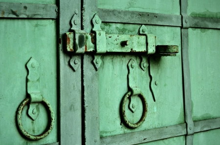 Old metal gate  of the monastery closed and bolted photo