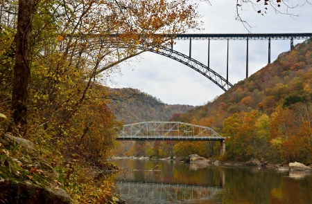 Two bridges over the mountain river in West Virginia