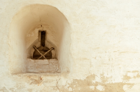 loophole: Loophole in a wall of an old monastery