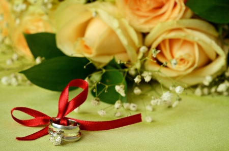 Engagement and wedding rings with flowers photo