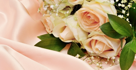 draped: Bouquet of roses on pink silk background