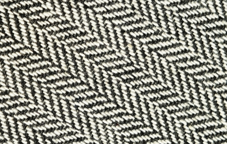 Closeup of black and white herringbone fabric photo