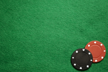 Poker chips on green cloth photo
