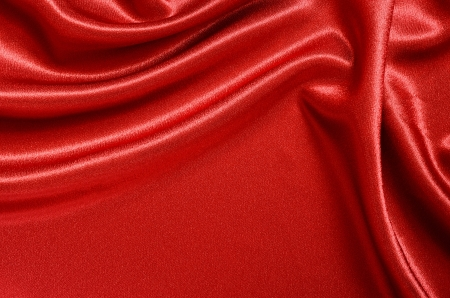 Red satin draped with soft folds