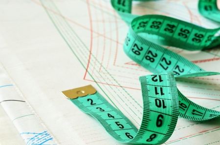 Measuring tape on patterns of new dress photo