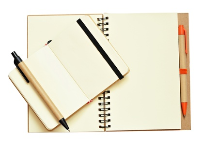 Opened notebooks and pens isolated on white photo