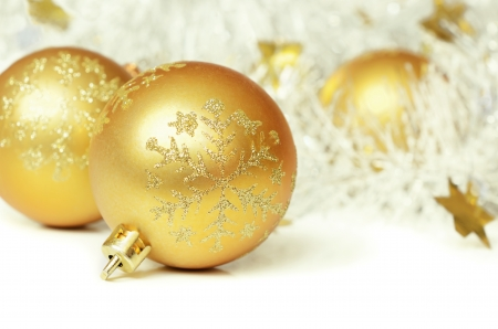 Christmas balls with tinsel on a white background photo