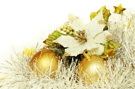 Christmas balls with tinsel and poinsettia on a white background Фото со стока