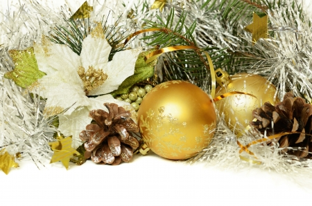Christmas balls with tinsel, cones and artificial poinsettia on white background photo