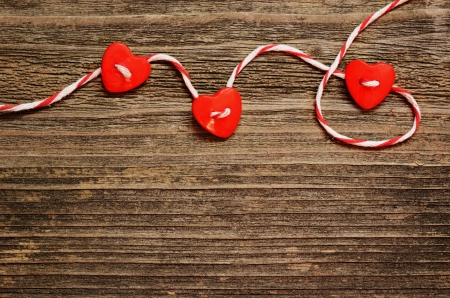 Hearts tied with red ribbon on wooden background photo