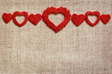 valentine's: Red hearts line on gray canvas background for Valentine s day