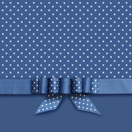 Blue ribbon with a bow on blue and white background