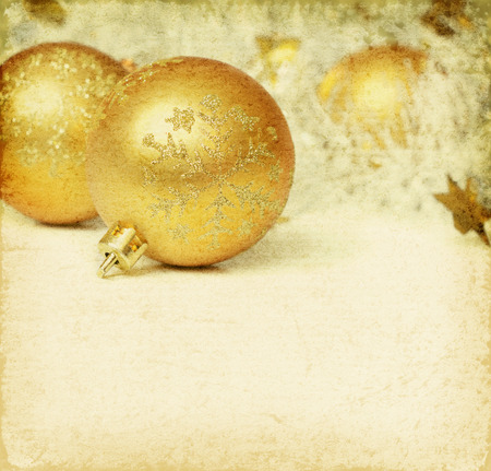 festoon: Christmas balls with tinsel on a old background