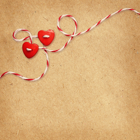 Two hearts tied with rope on craft paper background for Valentine photo
