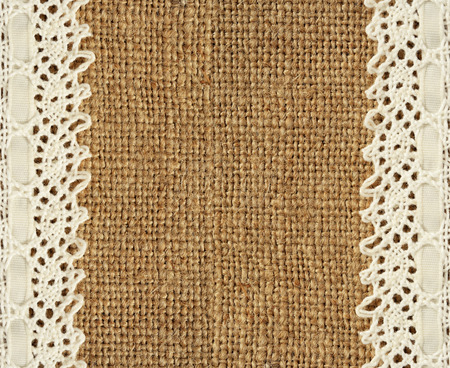 edges: Burlap with lace edges for background Stock Photo
