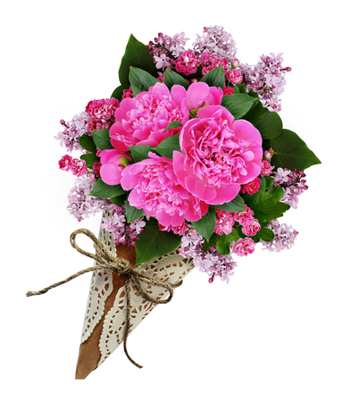 cornet: Pink peony flowers bouquet in a craft paper cornet isolated on white