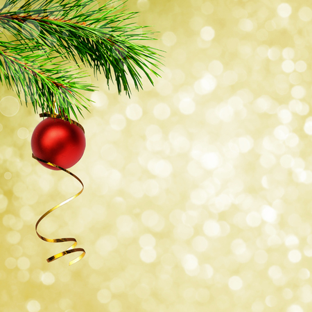 Christmas corner decoration with pine twigs and red ball on holiday background