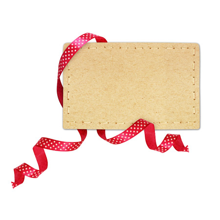 Pink silk polka dot ribbon and a card isolated on white