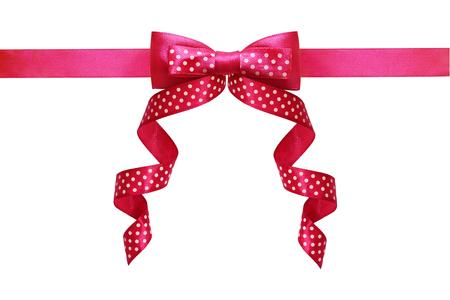 Pink silk polka dot ribbon bow isolated on white