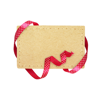 Pink silk polka dot ribbon and a tag isolated on white