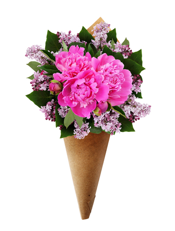 cornet: Bouquet of pink peonies and lilac flowers in a craft paper cornet isolated on white