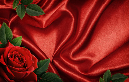 satin: Red satin fabric draped in the form of heart and red rose for Valentines day background