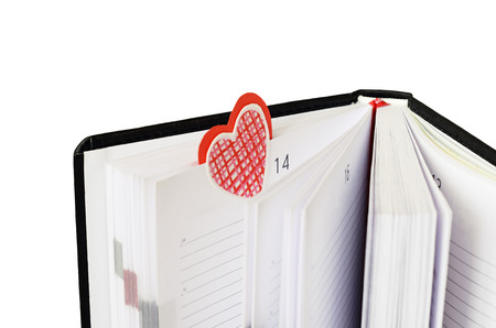 buiseness: Bookmark in a notebook for Valentines Day isolated on white