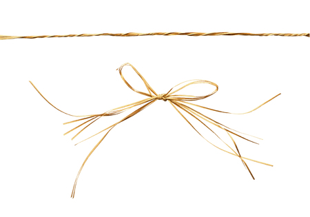convolute: Beige raffia bow and rope isolated on white