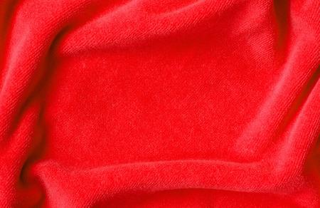 Red draped velvet textile for background Stock Photo