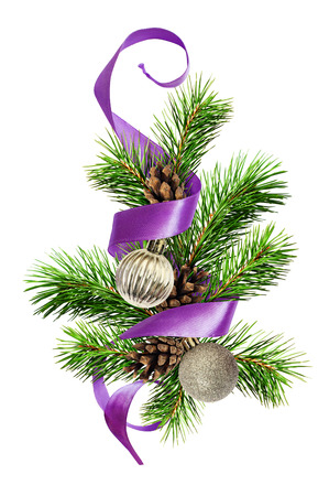 Christmas decoration with pine twigs, silver balls and purple ribbon isolated on white background