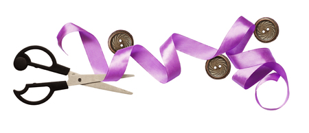 Curled purple silk ribbon, buttons and scissors isolated on white background. Stock Photo