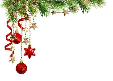 Christmas arrangement with green pine twigs, hanging red decorations and silk twisted ribbons isolated on white background