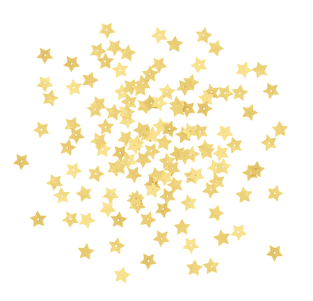 Scattered gold star shape confetti isolated on white