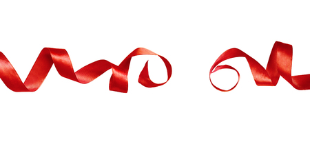 Red silk twisted ribbons isolated on white background