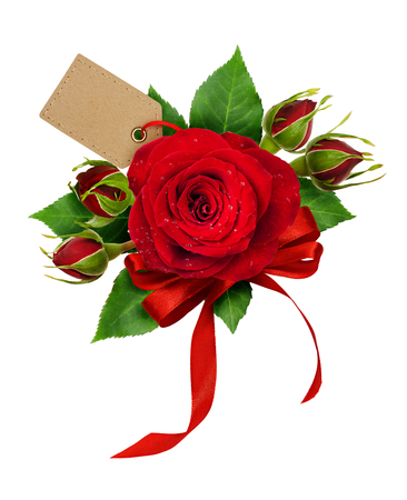 Festive arrangement for Valentine's Day with red rose flowers, tag and silk ribbon bow isolated on white background. Flat lay. Top view. Stock Photo