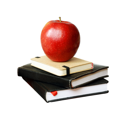 Notebooks and an apple isolated on white
