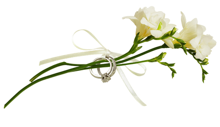 White freesia flowers and two golden rings tied with silk ribbon stock photo white freesia flowers and two golden rings tied with silk ribbon bow isolated on white background engagement or wedding concept mightylinksfo