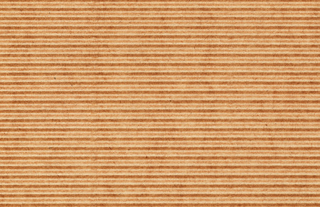 Texture of waved brown craft cardboard for background