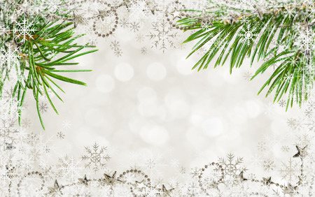 Christmas holiday background with snowflakes, pine twigs and garlands