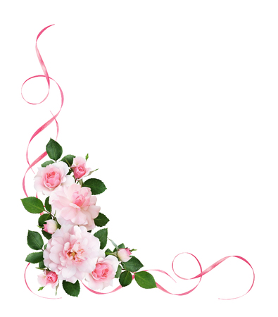 Pink rose flowers and satin ribbons in a floral corner arrangement isolated on white background. Flat lay. Top view.