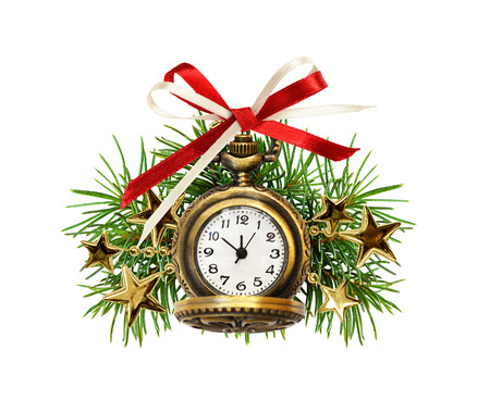 Red ribbon bow and Christmas clock with pine twigs and golden garlands isolated on white. Holiday time.